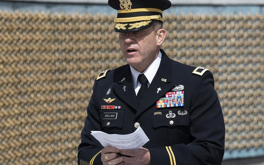 Chaplain (Col.) Michael Shellman, the Military District of Washington's command chaplain, delivers the invocation during a ceremony at the National World War II Memorial in Washington, D.C. on May 8, 2021, the anniversary of the end of the war in Europe.