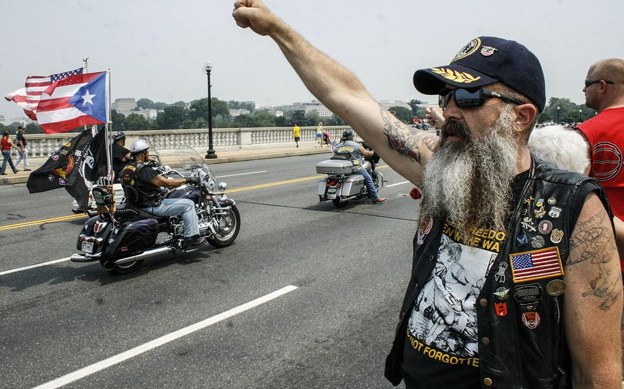 In a May, 2007 photo, a spectator cheers Rolling Thunder riders along as they cross into the District of Columbia.