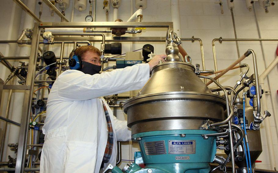 Biologist Joe Kragl operates a centrifuge in the extraction phase, May 11, 2021, in the Chemical Biological Center at Aberdeen Proving Ground, Md. It contains a bucket that functions like a large salad spinner, separating the microbes from the broth.
