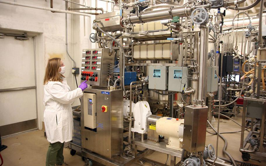 Anna Crumbley, a research chemical engineer, removes the solids from a new batch of fermented microorganisms, May 11, 2021 at Aberdeen Proving Ground, Md. The Chemical Biological Center is working on using bacteria to make missile propellant, among other applications.