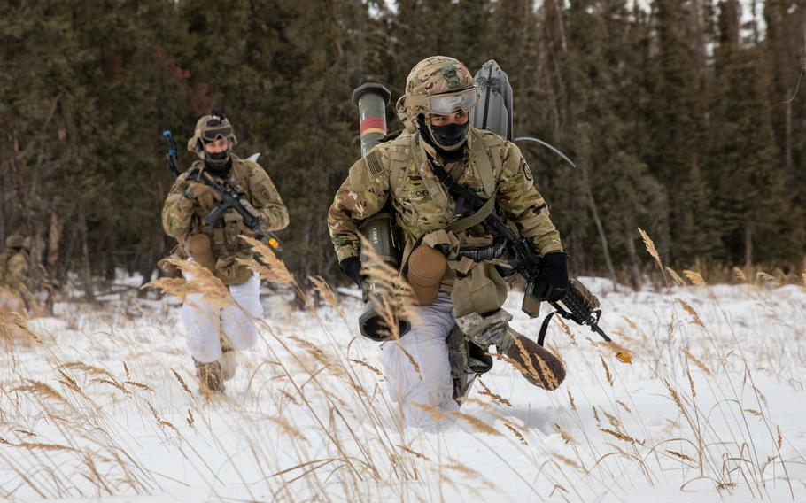 Paratroopers with 4th Infantry Brigade Combat Team (Airborne), 25th Infantry Division, cross a danger area during an assault exercise at Donnelley Training Area, Alaska, Feb. 11, 2021. Army scientists are looking into several methods for enhancing the ''thermal toughness'' of soldiers and making sure they don't succumb to frostbite and hypothermia.