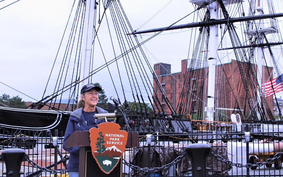 Dr. Lesa Staubus, a staff veterinarian with the American Humane, speaks during a brief canine adoption ceremony for U.S. Marine veteran Brendan Cabey and his former military working dog Ramos in front of the USS Constitution in Boston, on Sept. 11, 2020.