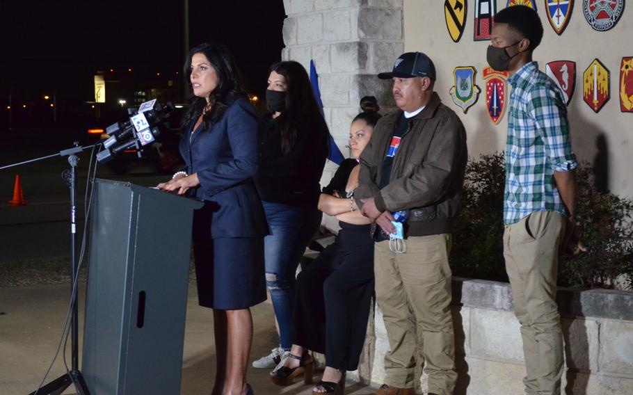 Natalie Khawam, attorney for the family of Spc. Vanessa Guillen, speaks Tuesday evening during a news conference outside the main entrance to Fort Hood, Texas. Along with Guillen's parents, her sister and an Army friend, Khawam met with base leadership, toured several sites and visited the location of the future Guillen Gate, named in honor of the slain soldier.
