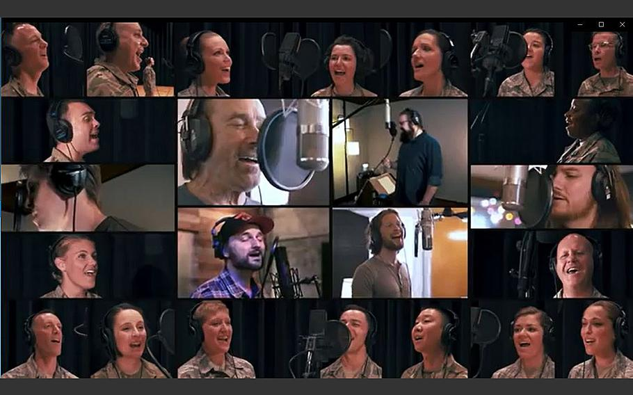 """A video screen grab shows country music singer Lee Greenwood, joined by members of the U.S. Air Force Band and singers with the a cappella group Home Free producing a new version of Greenwood's iconic """"God Bless the U.S.A."""""""