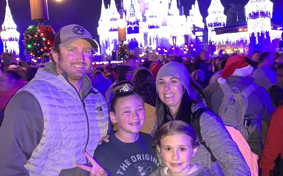 Green Beret Sgt. 1st Class Rich Stayskal poses with his daughter Addysin, 11, wife Meg and daughter Carly, 10, on a trip to Disney World in Nov. 2018 during a break in treatments. Stayskal is battling  metastatic stage IV lung cancer after military doctors failed to diagnose him for months in 2017.