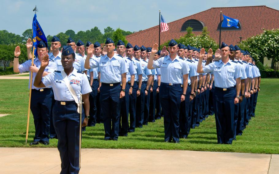 Officer Training School cadets take the oath of office during their graduation parade at Maxwell Air Force Base, Ala., June 2016. The Air Force will test a program that accelerates OTS training for senior noncommissioned officers, cutting the course to 14 days.