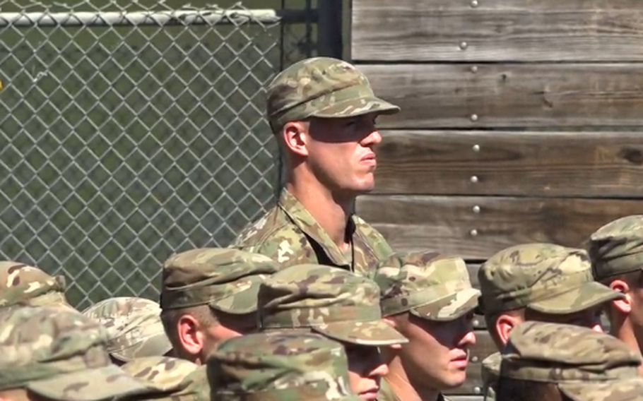 Second Lt. Marshall Plumlee, a member of Duke University's 2015 NCAA Championship basketball team and former New York Knicks player, stands in formation in this screengrab from a video.