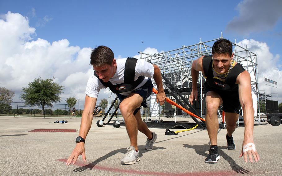 Air Force Capt. Noah Palicia, left, and Army Lt. Col. Eric Palicia, who are brothers, will compete against other members of their own service branches Thursday in the Alpha Warrior competition at Retama Park near San Antonio. If both finish within the top three of their respective branches, they will face each other Saturday in an inter-service competition.