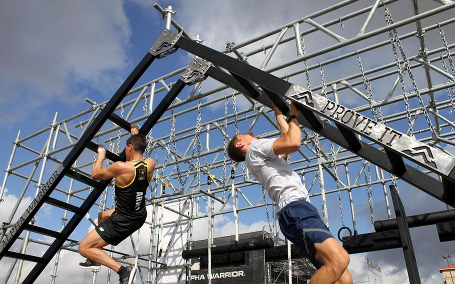 Army Lt. Col. Eric Palicia, left, and Air Force Capt. Noah Palicia, who are brothers, will compete against other members of their service branches Thursday in the Alpha Warrior competition at Retama Park near San Antonio. Each traveled more than 20 hours from overseas bases to compete on the 32-obstacle course.