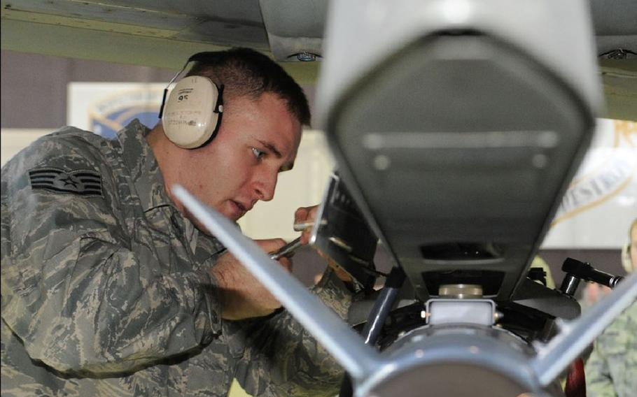 Then-Staff Sgt. Joshua Kidd secures a GBU-38 Bomb to an F-16 in 2012. A building at Barksdale Air Force Base, La., now bears his name.