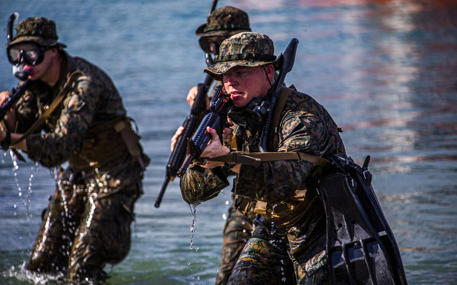 U.S. Marines with 1st Battalion, 3rd Marine Regiment, hit the shore during an amphibious assault exercise on Marine Corps Base Hawaii, April 28, 2020.