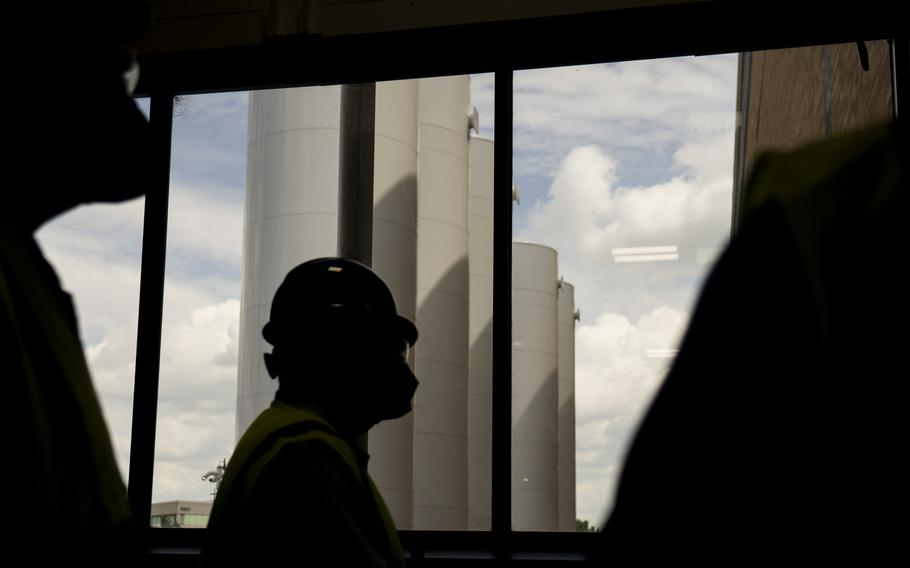 Silos filled with liquid carbon dioxide for making dry ice are next to Pfizer's manufacturing facility in Kalamazoo, Mich.