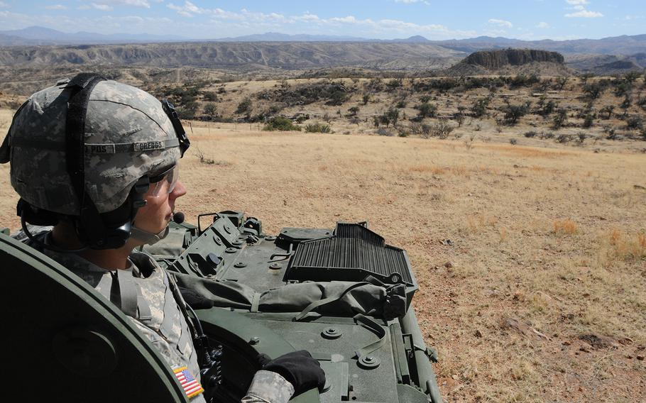 A soldier from the 1st Armored Division, Fort Bliss, Texas, conducts observations along the international border near Nogales, Ariz., Feb. 27, 2019.