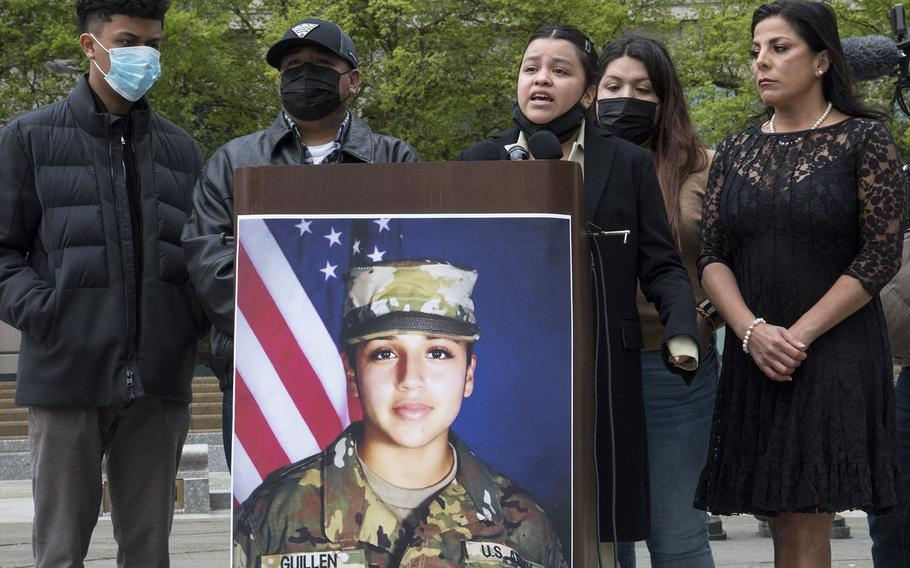 Backed by other family members and attorney Natalie Khawam, right, Spc. Vanessa Guillen's sister Lupe speaks at a news conference marking the first anniversary of the Fort Hood soldier's killing, April 22, 2021, at the Navy Memorial in Washington, D.C.