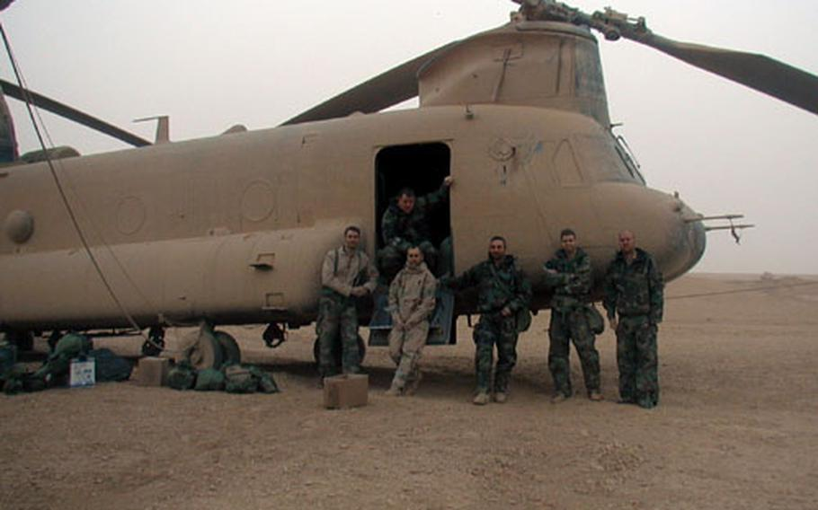 The crew of one of the three stricken Chinook helicopters poses after their safe landing. They are (from left) Sgt. Lance Reynolds, 29, the flight engineer; Staff Sgt. Michael O'Keefe, 33, the door gunner; Chief Warrant Officer 2 Randy Summerlin, 31, the jump-seat pilot; Chief Warrant Officer 3 Dan Helus, 37, the pilot-in-command; Chief Warrant Officer 2 Clay Rekow, 27, the right-seat pilot; and Sgt. Kevin Ellison, 26, the crew chief.