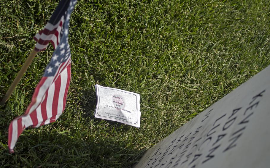 Flags shared space with artifacts and tributes left at the tombstones by family and friends.