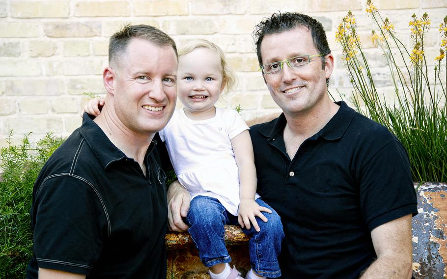 Army Lt. Col. Josh Hawley-Molloy, left, poses with his husband, Johnathon, and daughter Kylie. Hawley-Molloy, stationed in San Antonio, said that although last week's Supreme Court decision legalizing same-sex marriage across the U.S. was a relief to gay servicemembers, it leaves unanswered questions about parental rights in states like Texas.