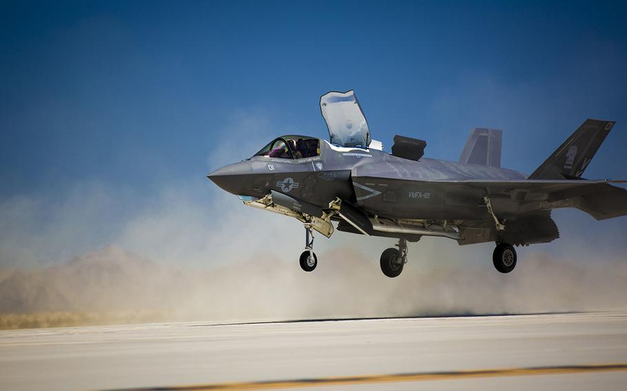 An F-35B Lightning II with Marine Fighter Attack Squadron 121, based out of Marine Corps Air Station Yuma, Ariz., performs a vertical landing as part of required flying field carrier landing practices at the station?s auxiliary landing field, on April 27, 2015.