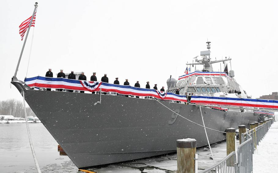 Sailors man the rails of the littoral combat ship USS Little Rock during its December commissioning ceremony in Buffalo, N.Y.