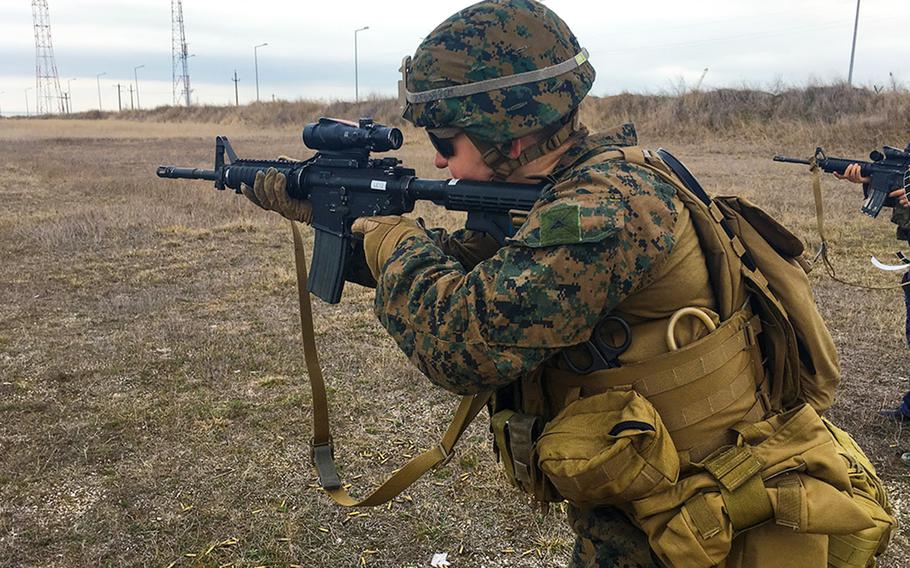 Lance Cpl. Alexandra Fox of the 26th Marine Expeditionary Unit shoots an M4 carbine at Capu Midia Training Area, Romania, March 14, 2018.