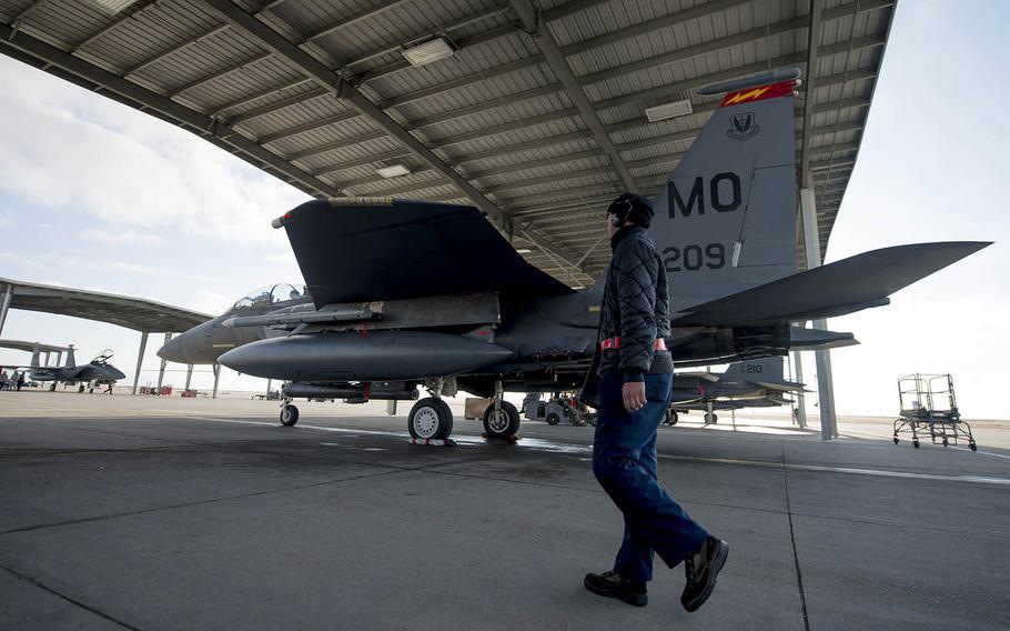 Senior Airman Zachary Dobsch, 366th Aircraft Maintenance Squadron crew chief, inspects an F-15E Strike Eagle in December at Mountain Home Air Force Base, Idaho.
