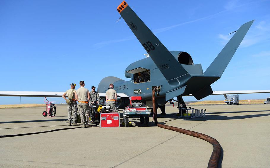 Airmen with 12th Aircraft Maintenance Unit RQ-4 Global Hawk prepare an RQ-4 for a flight at Beale Air Force Base, Calif., June 5, 2018.