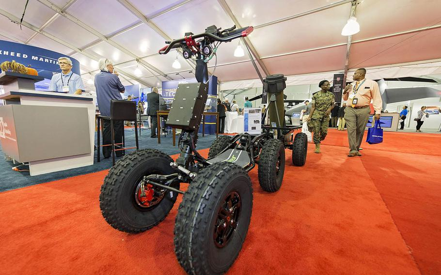 Visitors stroll by a display at the Modern Day Marine Military Exposition at Marine Corps Base Quantico, Va., Sept. 26, 2018. The event is a three-day showcase of the latest in defense manufacturing, science, technology and warfighting products by about 400 exhibitors.