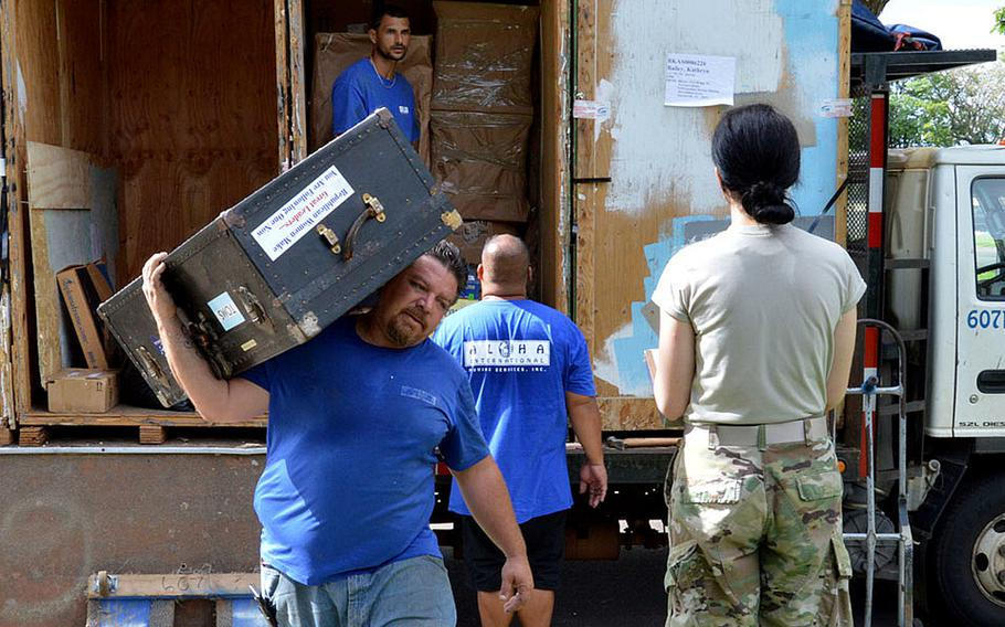 First Lt. Kathryn Bailey, a Black Hawk pilot with the 25th Infantry Division, supervises the delivery and unpacking of her household items on Wheeler Army Airfield, Hawaii, May 11, 2017.