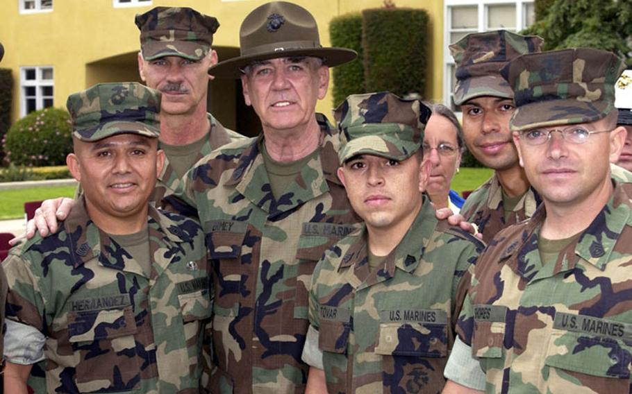 R. Lee Ermey, center, poses with Marines after receiving the honorary rank of gunnery sergeant in 2002.