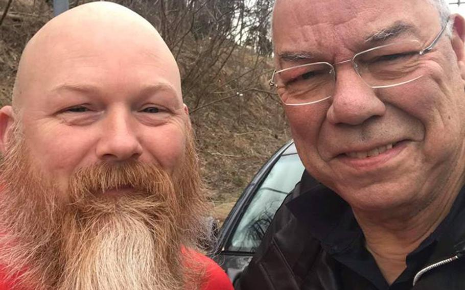 Former Secretary of State Colin Powell, right, poses with Anthony Maggert on the side of Interstate 495 near Walter Reed National Military Medical Center in Bethesda, Md., Wednesday, Jan. 23, 2019. The Good Samaritan stopped to help the retired four-star Army general change a flat tire.
