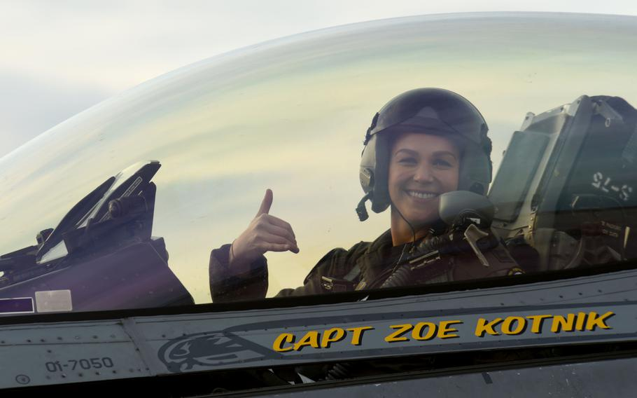 "U.S. Air Force Capt. Zoe ""SiS"" Kotnik, F-16 Viper Demonstration Team commander and pilot, smiles after a certification flight at Joint Base Langley-Eustis, Va., Jan. 29, 2019. Kotnik performed more than 30 practice missions before the certification."