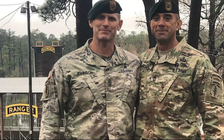 This screenshot from a Jan. 30, 2019, U.S. Army video shows Master Sgt. Jole Alvarez (right) of 1st Special Forces Group (Airborne) posing for a photo with a fellow Green Beret after Alvarez, 42, completed Ranger School at Fort Benning, Ga., in December 2018.