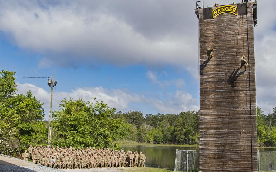 Soldiers from Ranger Class 05-18 look on as a rappelling demonstration takes place April 27, 2018, prior to the graduation ceremony for U.S. Army Ranger School at Fort Benning, Ga.