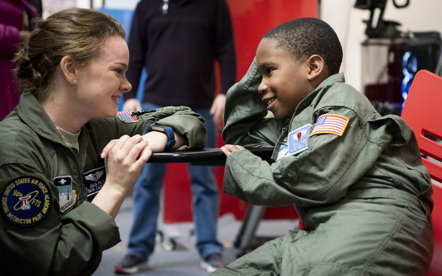 """Air Force Academy cadet Julia Pack talks with Je'Moni Ford, a 9-year-old """"Cadet for a Day"""" taking part in a joint program between the academy and the Make-A-Wish Foundation, on Friday, March 15, 2019. Je'Moni was diagnosed with a rare form of cancer in 2017 and endured six surgeries to remove the cancer and reconstruct his hand."""
