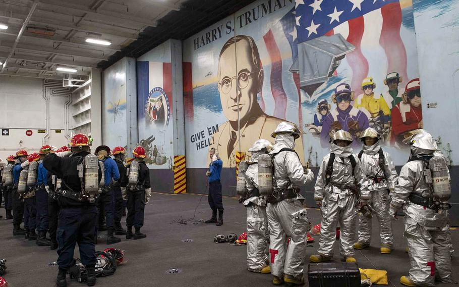 Sailors take part in a general quarters drill in the hangar bay of the aircraft carrier USS Harry S. Truman in the Atlantic Ocean, March 18, 2019.