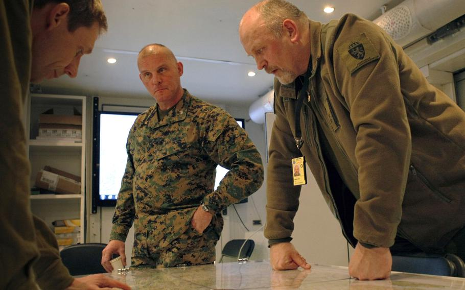 Col. Mark A. Smith, center, deputy commander of 24th Marine Regiment, 4th Marine Division, and Lt. Col. Ole Osteraas, commanding officer of Norwegian Host Nation Support Battalion, look over the area of operations map of Exercise Cold Response 12, in March 2012. Smith, whose prolific letters about his Marines were widely circulated during his command of the Marine Reserves 2nd Battalion, 24th Marine Regiment in Iraq, was buried Wednesday in Indianapolis, Indiana.