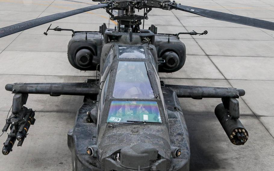 An AH-64 sits ready for take-off as the Apache pilots conduct their final pre-flight inspections inside the aircraft here in Afghanistan. The Army wants to boost flight pay and award pilots with incentive money for career achievements to stem a historic attrition rate in its aviation community.
