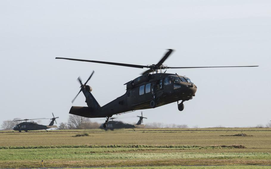 A U.S. Army UH-60 Black Hawk helicopter from the 1st Combat Aviation Brigade, 1st Infantry Division, lands for final staging before taking off from Chievres Air Base, Belgium, Feb. 7, 2019. The Army wants to boost flight pay and award pilots with incentive money for career achievements to stem a historic attrition rate in its aviation community.