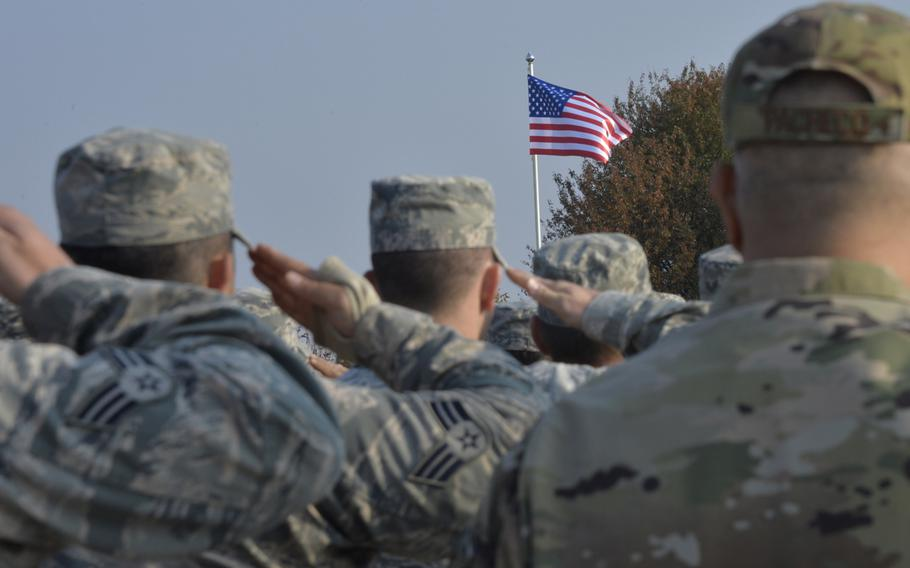 Airmen salute during the national anthem at the opening ceremony of the Clear Sky 2018 exercise at Starokostiantyniv Air Base, Ukraine, Oct. 8, 2018.