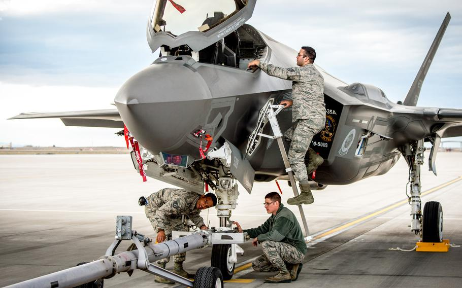 Aircraft maintainers Staff Sgt. Thomas Stewart, left, Senior Airman Justin Wilmarth and Staff Sgt. Chris Mauldin, on ladder, prepare to tow an F-35A at Mountain Home Air Force Base, Idaho, in 2016. A shortage of spare parts in the F-35 supply chain has reduced the jet?s mission readiness, a government watchdog has found.