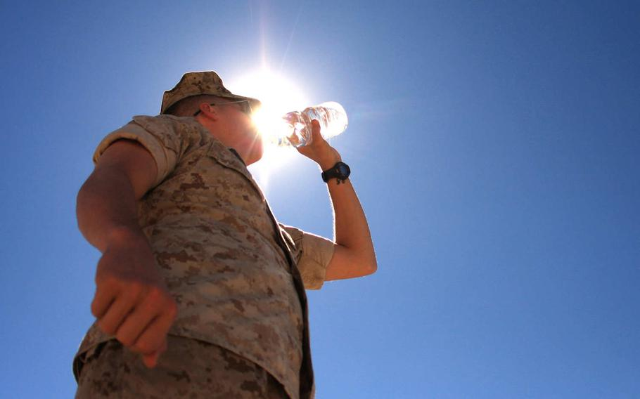 A Marine drinks water at Twentynine Palms, Calif. Heat-related illnesses increased among troops during the past five years, and young Marines and soldiers based in the southeastern U.S. were most at risk, according to a new military medical report.