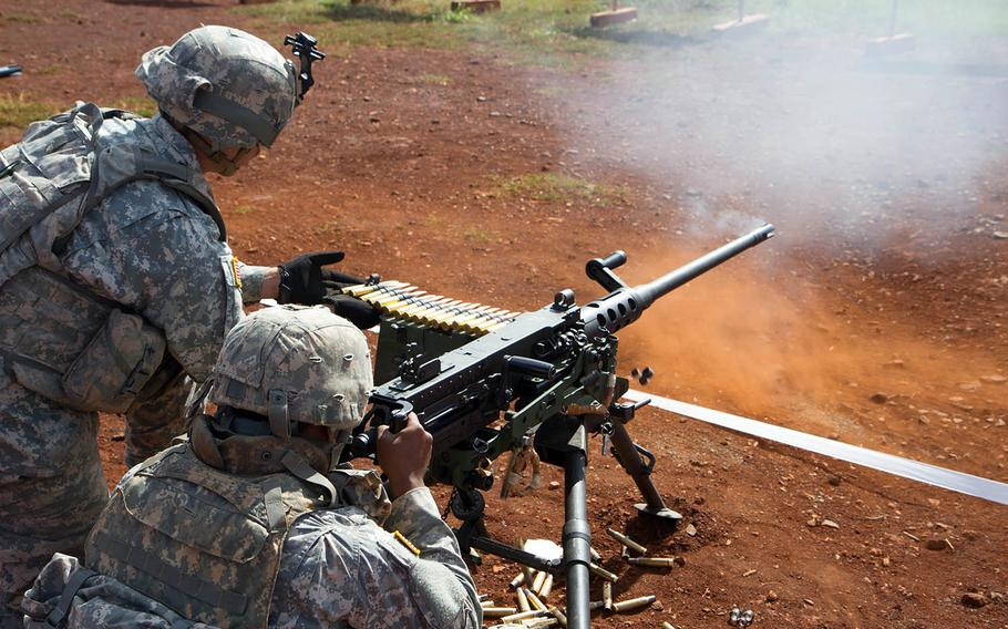 Soldiers fire an M2 Browning .50-caliber machine gun in April 2016 at the range at Schofield Barracks, Hawaii.