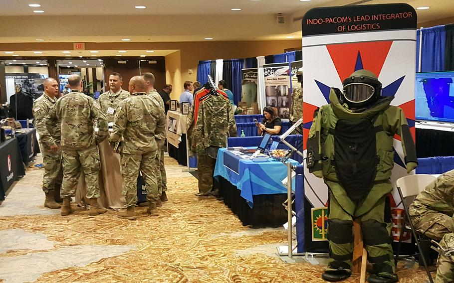 Visitors explore the exhibition hall at the Land Forces Pacific Symposium in Hawaii, Tuesday, May 21, 2019.