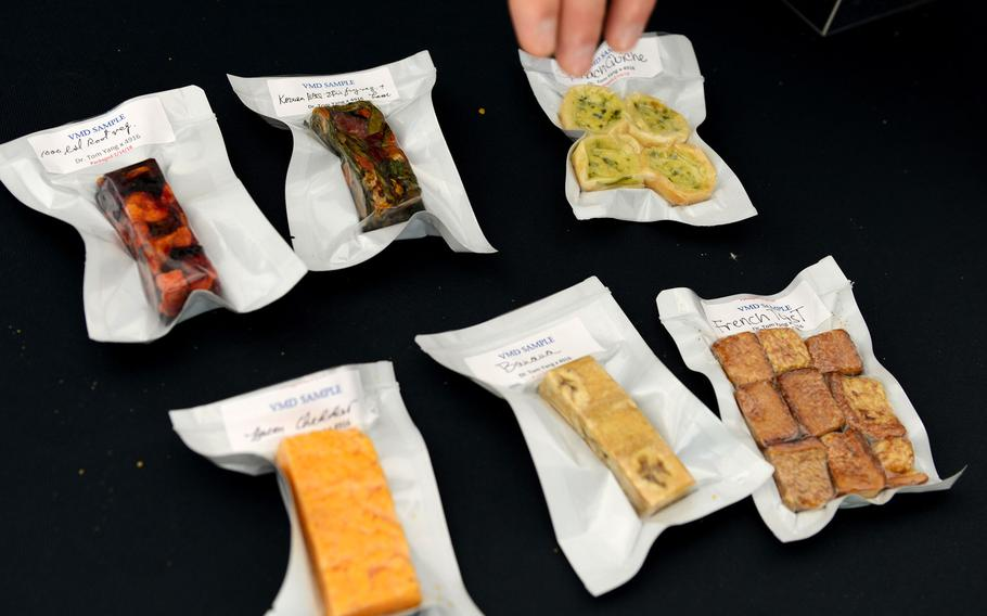 The prototype Close Combat Assault Ration on display at the Pentagon May 24, 2018 includes a tart cherry nut bar, cheddar cheese bar, mocha desert bar, vacuum-dried strawberries and trail mix of fruit and nuts, among other items that were vacuum microwave-dried.