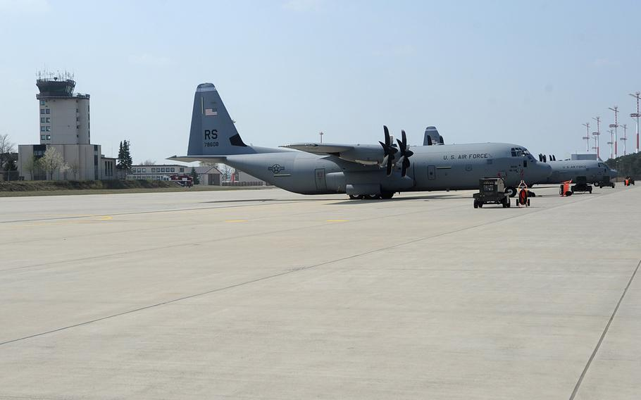 A pair of C-130 Hercules cargo planes sit on the tarmac at Ramstein Air Base, Germany. Nearly one-fourth of the Air Force's fleet of C-130s is being pulled for inspection after ''atypical'' cracks were found on the lower center wing joint during scheduled depot maintenance, Air Mobility Command announced late Wednesday, Aug. 7, 2019.