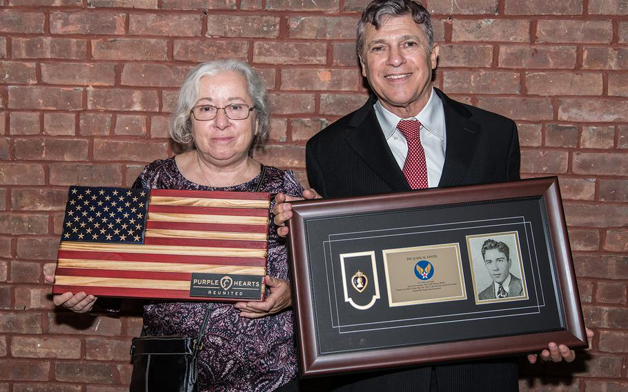 Joyce Bailey, left, and David Algranti, niece and nephew of Purple Heart recipient Army Air Corps Pfc. John Epstis, recieve their uncle's Purple Heart during a ceremony at the New York City Fire Museum in Manhattan, Aug. 7, 2019.