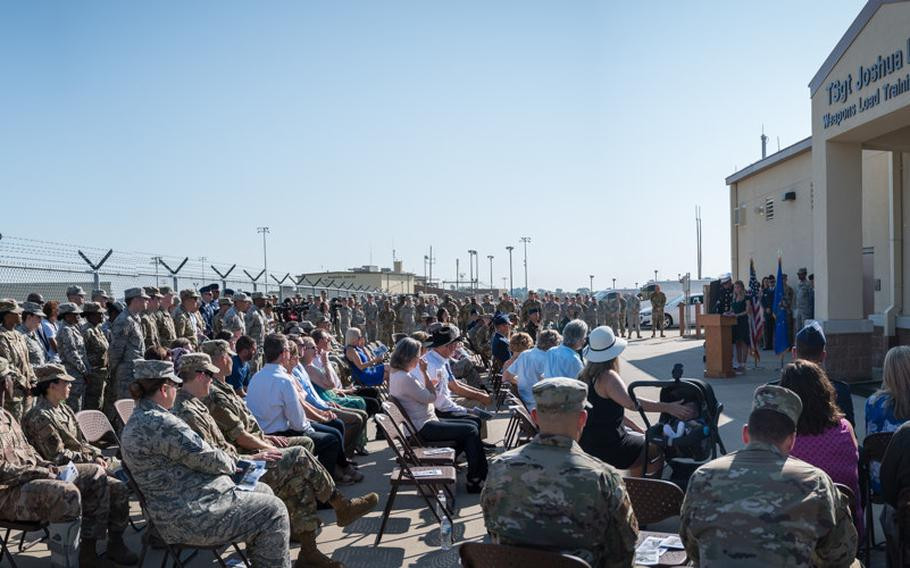 The Kidd family, friends and airmen of the 2nd Bomb Wing gather for the renaming of the Weapons Load Training facility at Barksdale Air Force Base, La., to the Kidd Weapons Load Training facility in honor of the late Tech. Sgt. Joshua L. Kidd Aug. 16, 2019.