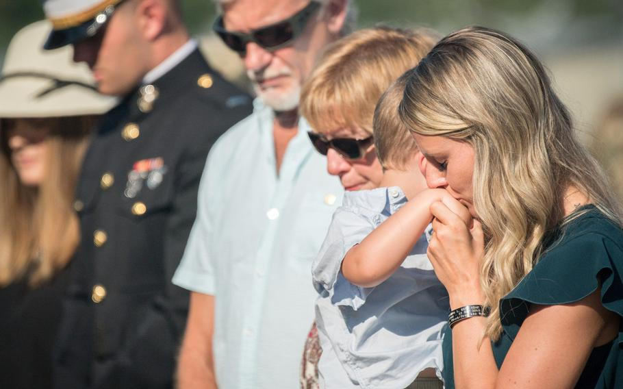 Alyssa Kidd comforts Beckham Kidd while the family comes together for the renaming of the Weapons Load Training facility at Barksdale Air Force Base, La., to the Kidd Weapons Load Training facility in honor of the late Tech. Sgt. Joshua L. Kidd Aug. 16, 2019. Kidd was killed last fall in an attempted break-in of his vehicle outside his home in Bossier, La.