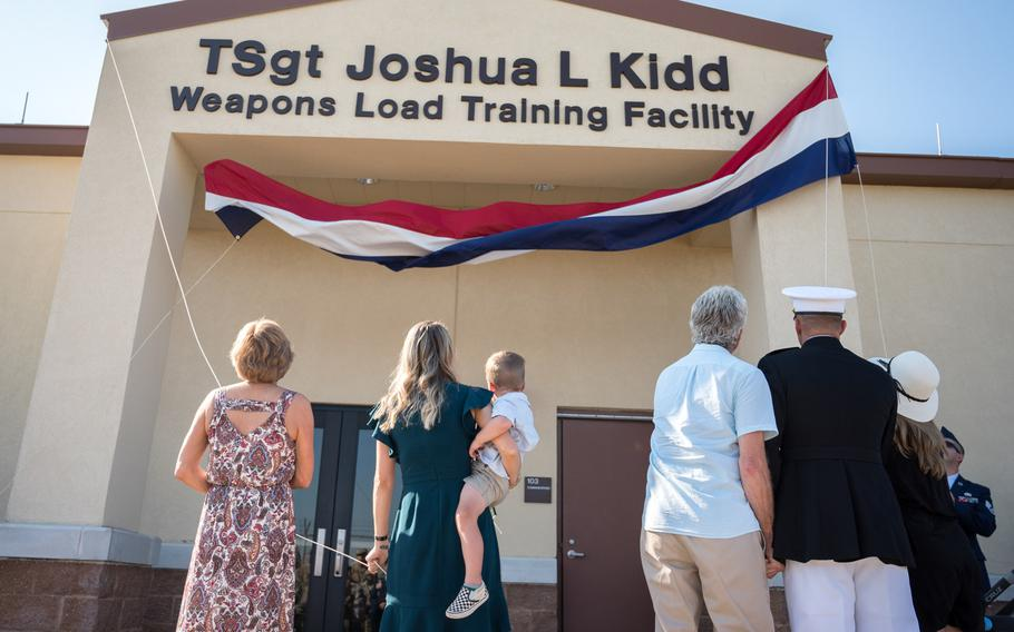The Kidd family unveil the new name of the Kidd Weapons Load Training facility at Barksdale Air Force Base, La., in honor of the late Tech. Sgt. Joshua L. Kidd, Aug. 16, 2019. Kidd was killed last fall in an attempted break-in of his vehicle outside his home in Bossier, La.