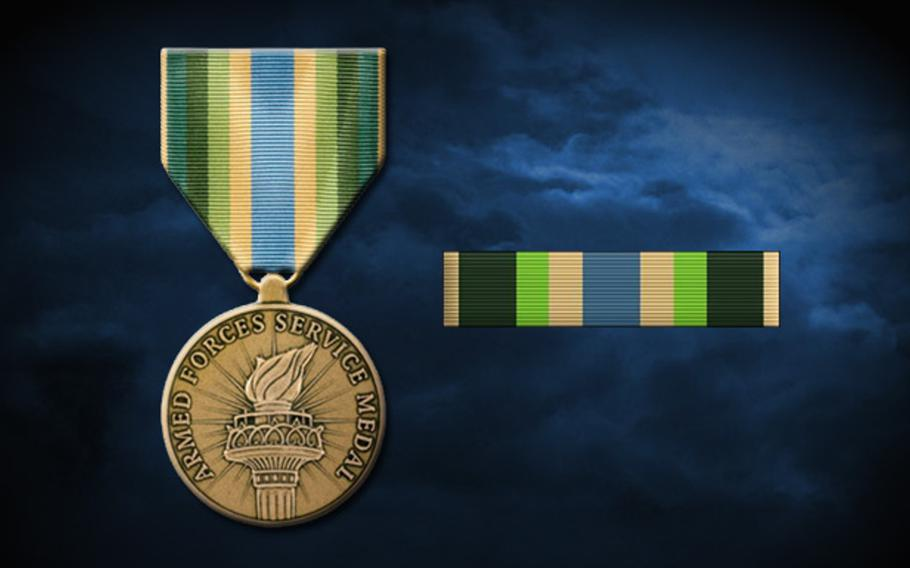 The Armed Forces Service Medal has a green, blue and yellow ribbon attached to a bronze medal featuring a Statue of Liberty style torch. Troops who served along the Mexican border since last spring have been authorized to receive the medal.